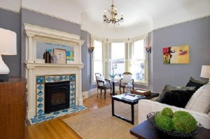 Beautiful original details include the fireplace and moldings